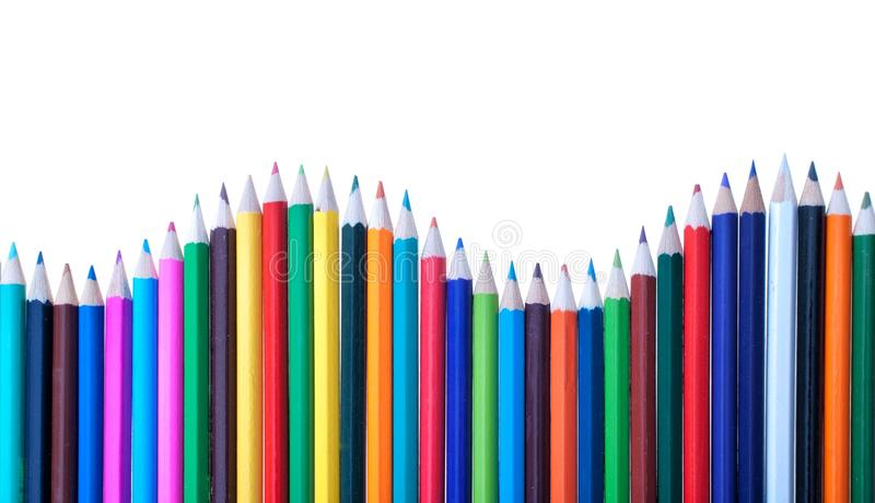 Colourful pencils in shape of wave royalty free stock photos