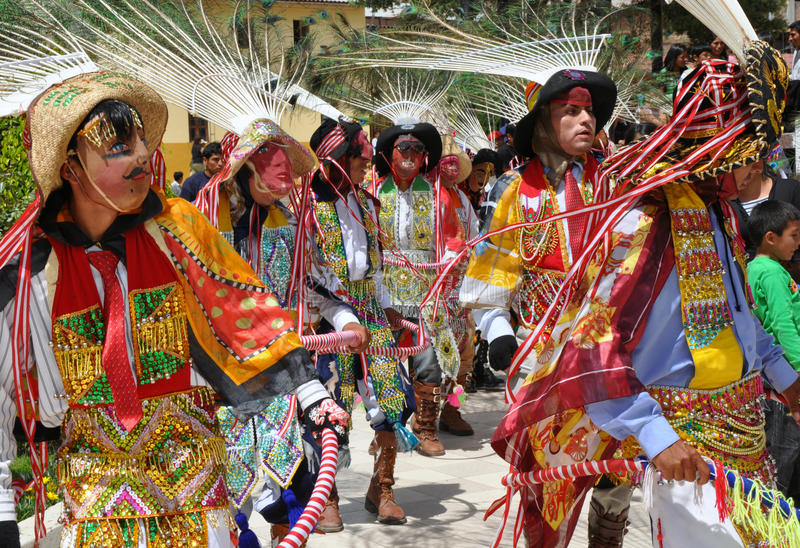 Colourful Peruvian Dancers. Festive Peruvian folklore dancers performing in the street royalty free stock photography