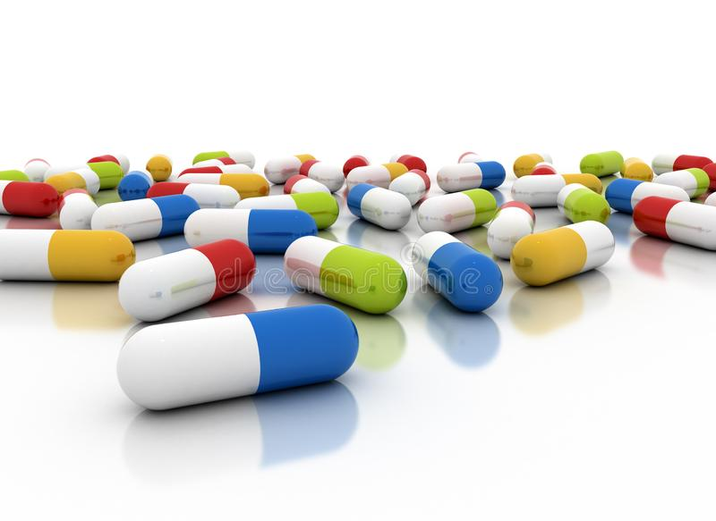 Colourful pills scattered on white background stock images