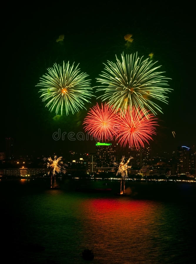 4 Colourful pink firework explode on popular beach stock photography