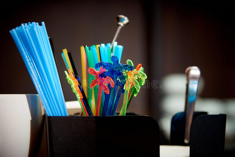 Colourful Plastic Drinking Straws.Bright multicolored straws on the bar royalty free stock photos