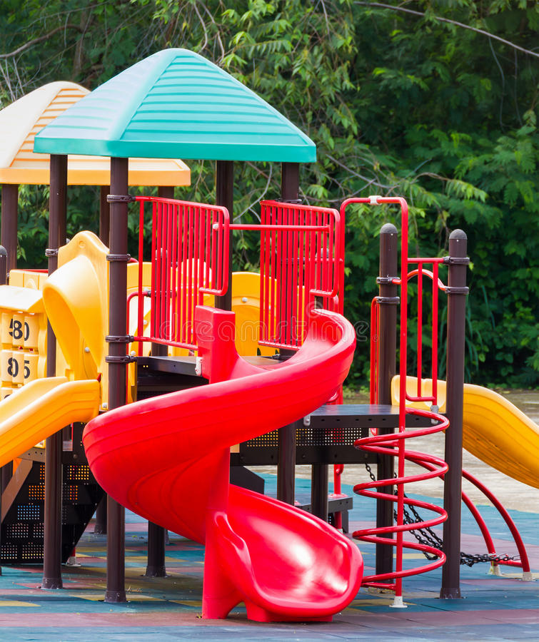 Colourful playground equipment. At an outdoor park royalty free stock photo