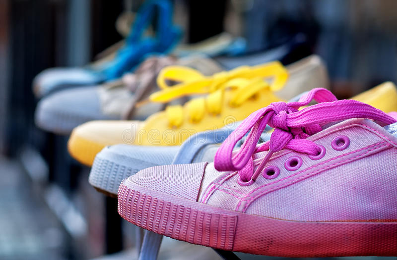 Colourful plimsolls in a row royalty free stock photo