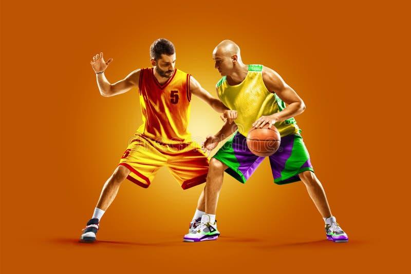 Colourful professional basketball players isolated over orange background stock image