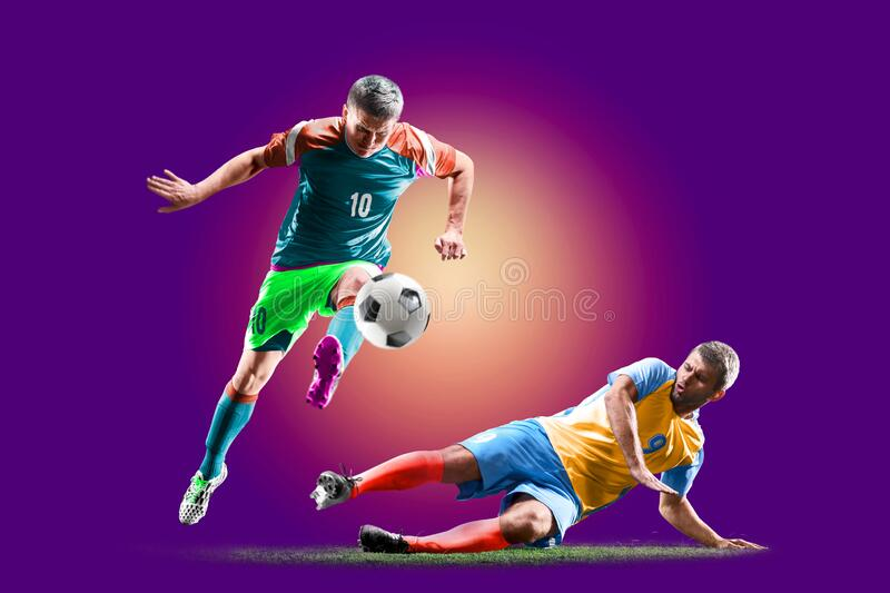 Colourful professional soccer players isolated over purple background stock images