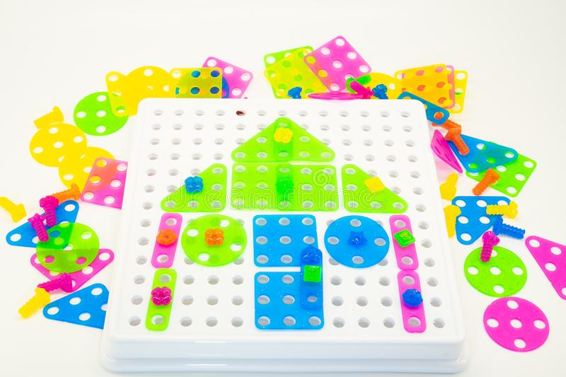Colourful puzzles with house concept on a white background royalty free stock photo