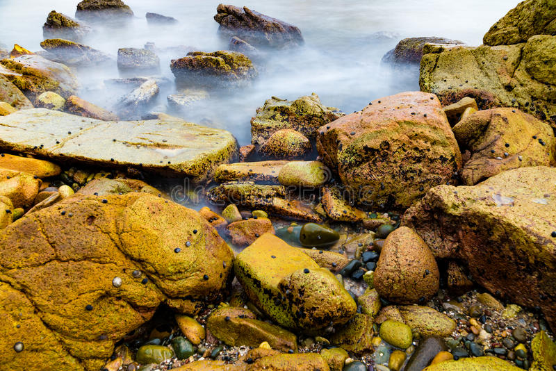 Colourful rocks and water stock images