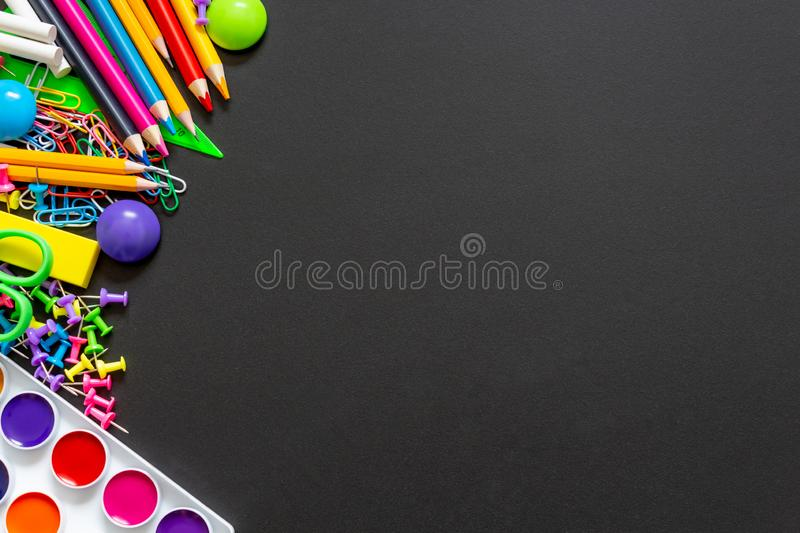 Colourful school supplies. Top view. Copy space. stock illustration