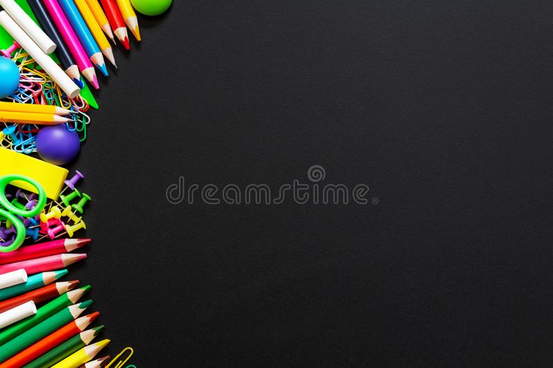 Colourful school supplies. Top view. Copy space. stock image