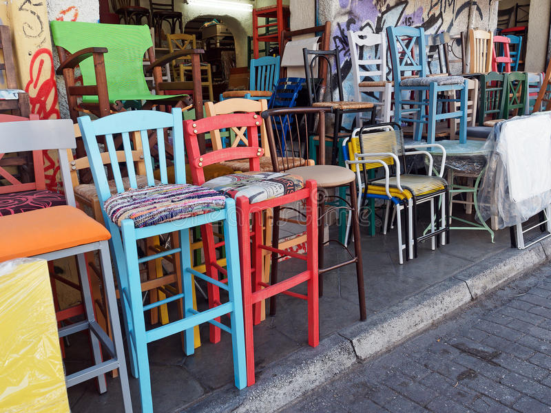 Colourful Second Hand Chairs, Plaka, Athens, Greece. Many reconditioned and repainted second hand chairs, stacked outside a shop in the Athens Flea Market, Plaka royalty free stock image