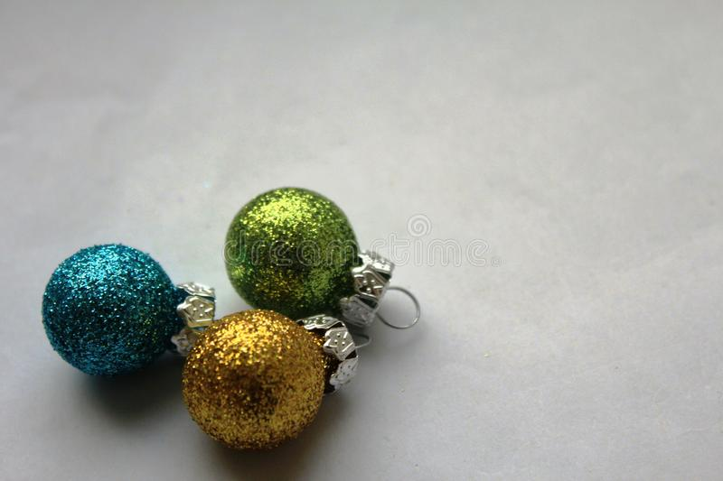 Colourful shiny Christmas baubles stock photography