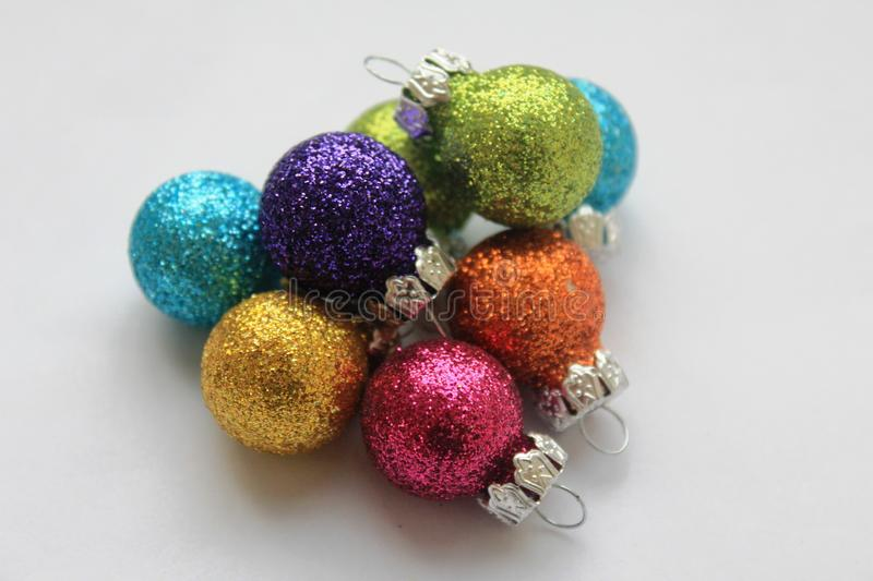Colourful shiny Christmas baubles stock images