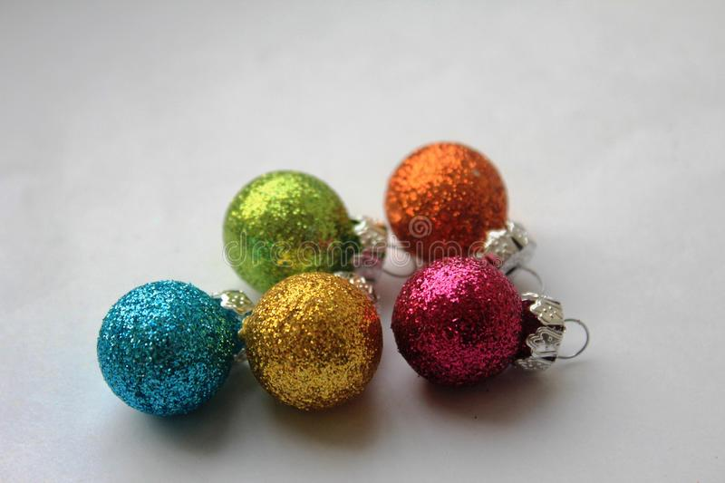 Colourful shiny Christmas baubles royalty free stock photography