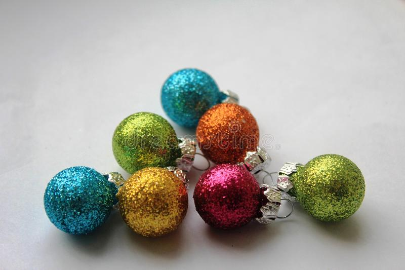 Colourful shiny Christmas baubles royalty free stock photo