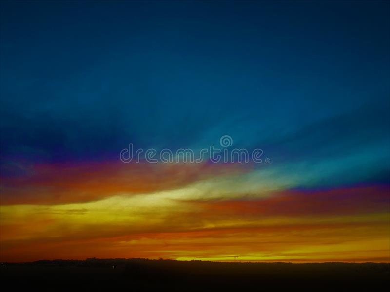 Colourful sky, sunset, deep penetrating light, lost in paradise royalty free stock photos