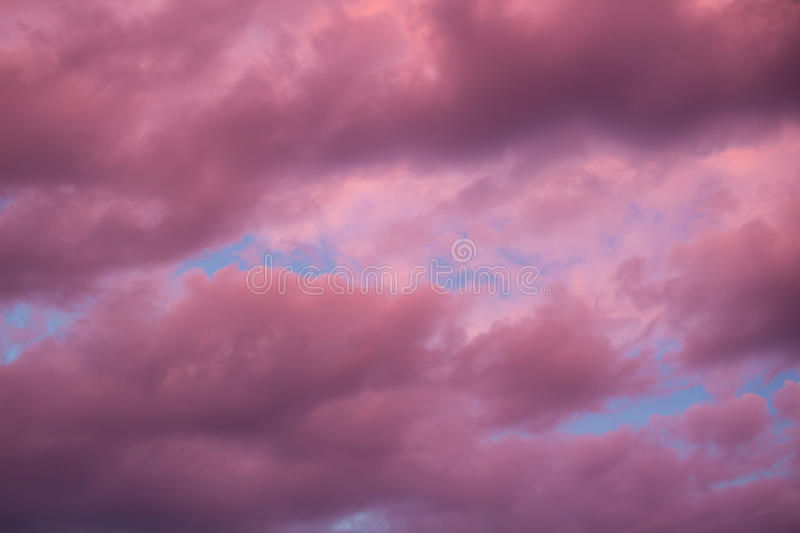 Colourful skyscape with purple clouds at sudown dusk. Colourful skyscape with versicolored purple clouds at sunset dusk royalty free stock photos