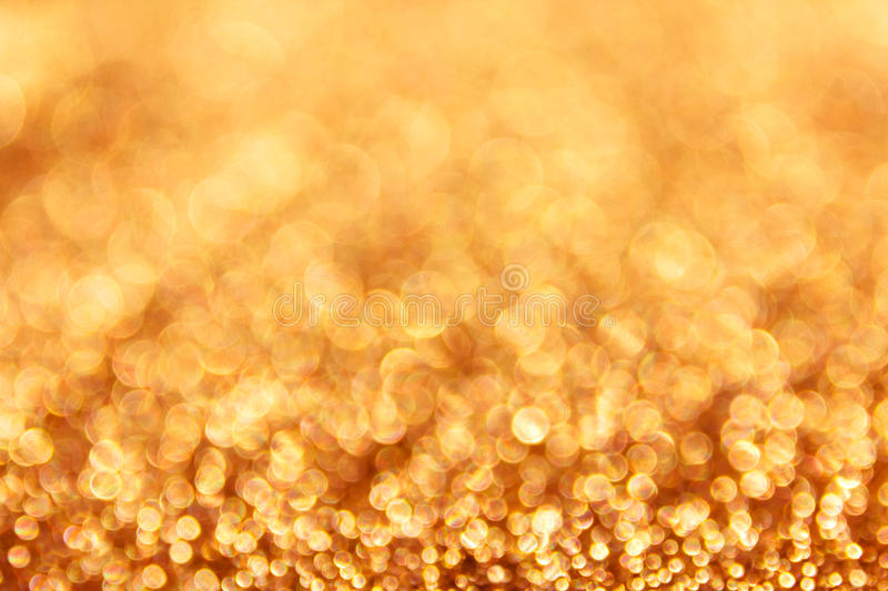 Colourful spark and blow WONDERFUL golden bokeh. Colourful spark and blow natural bokeh in wonderful golden fantasy mood background stock image