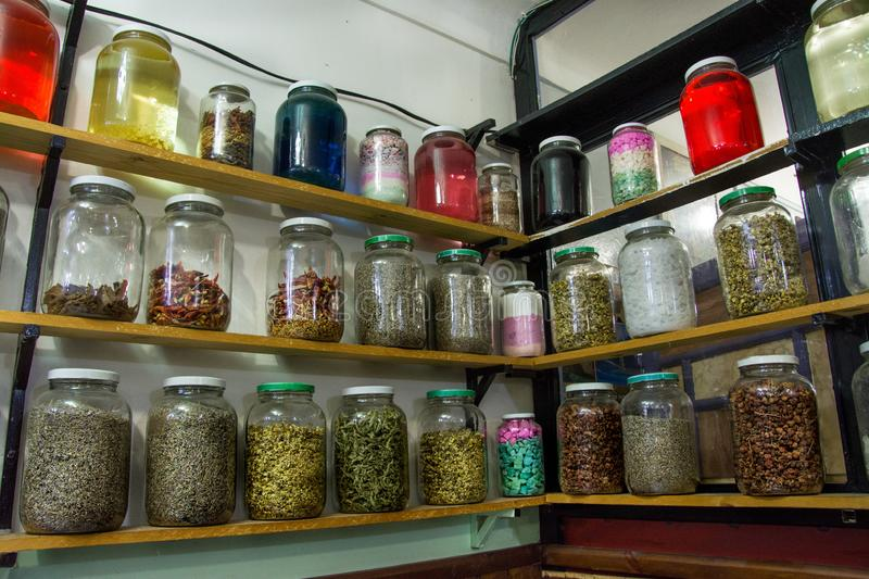 Colourful spices and herbs in jars stock photos