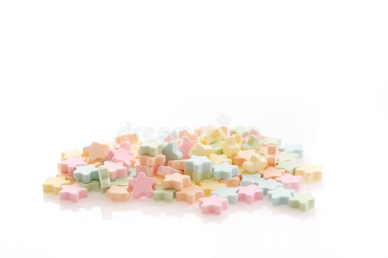 Colourful Star Milk pellets isolated in white stock photo