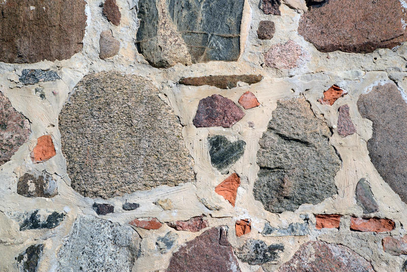 Colourful stone wall texture. Photo of a colourful stone wall. May be used as a background royalty free stock photo