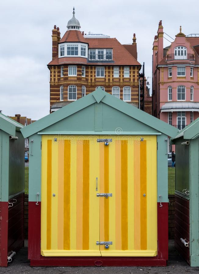 Colourful striped wooden beach hut on the sea front in Hove, Sussex, UK. Colourful wooden beach hut on the sea front in Hove, East Sussex, UK, with blocks of royalty free stock image
