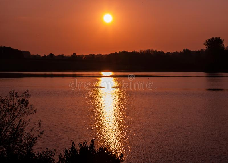 Colourful sunrise with reflection at Furzton Lake, Milton Keynes. United Kingdom stock photography