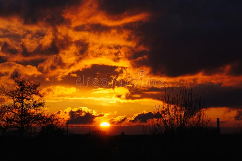 Sunshine after the storms. Colourful sunset as the stormy clouds begin to move away after some thunderstorms royalty free stock photos