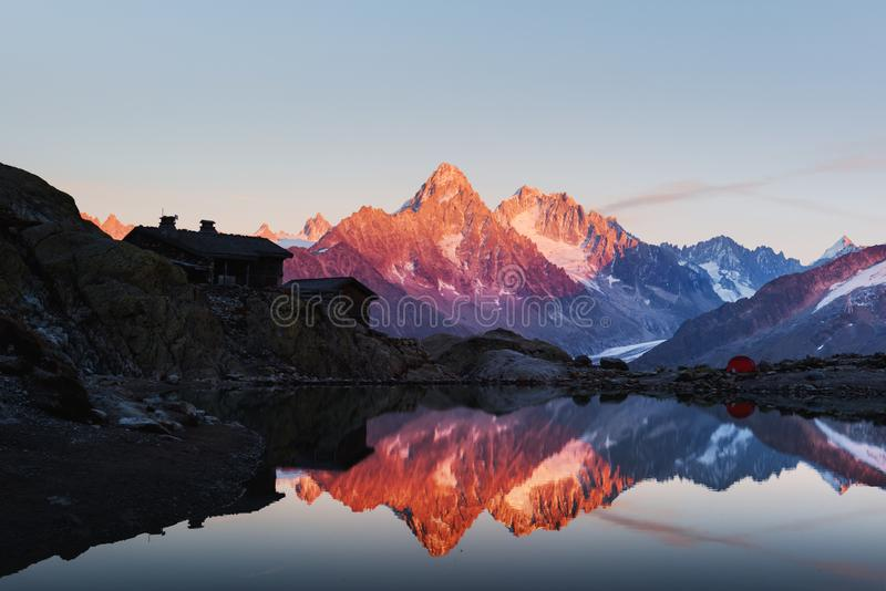 Colourful sunset on Lac Blanc lake in France Alps. Monte Bianco mountain range on background. Vallon de Berard Nature Preserve, Chamonix, Graian Alps stock photo