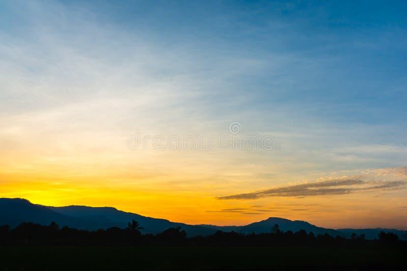 Colourful sunset sky with mountain range. stock photos