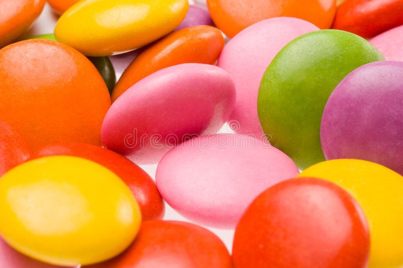 Colourful sweets. Close up of colorful smarties stock images