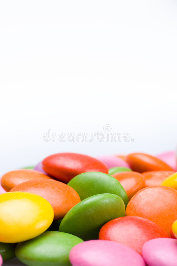 Colourful sweets. Close up of colorful smarties stock photo