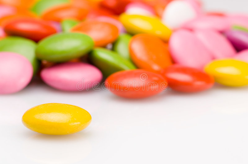 Colourful sweets. Close up of colorful smarties royalty free stock photo