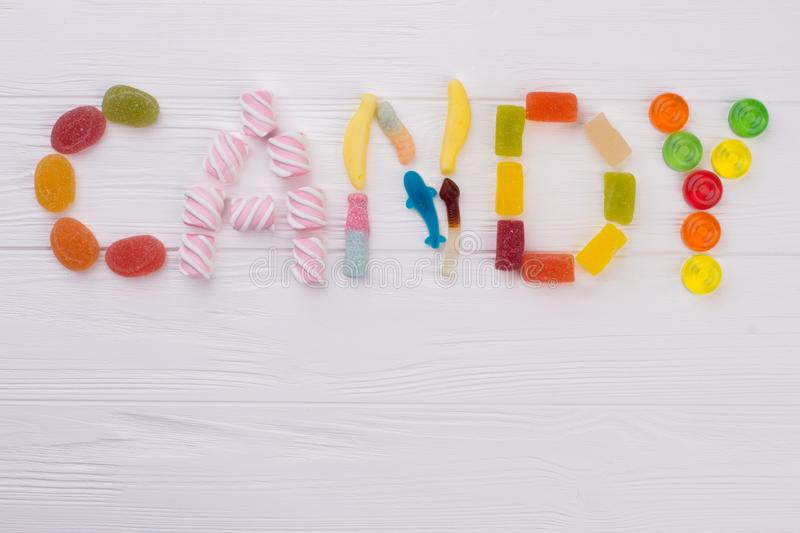 Colourful sweets spelling the word CANDY. royalty free stock photo