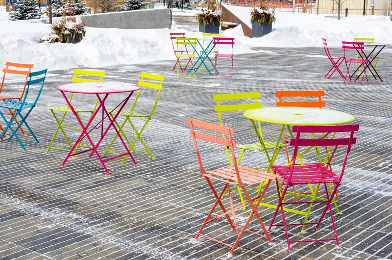 Colourful Table and Chairs on a Patio stock images