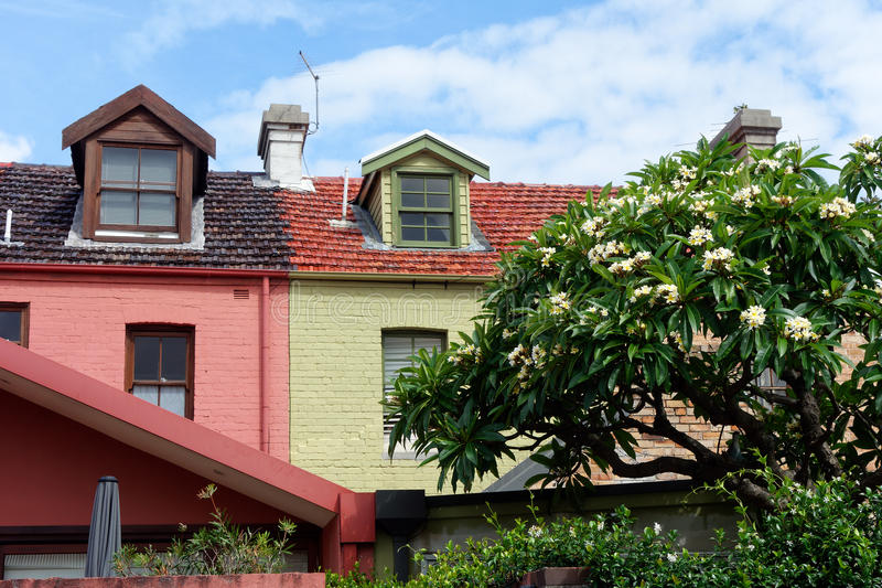 Colourful Terrace Houses. Colorful early 20th century terrace, or row, houses with attic windows royalty free stock image