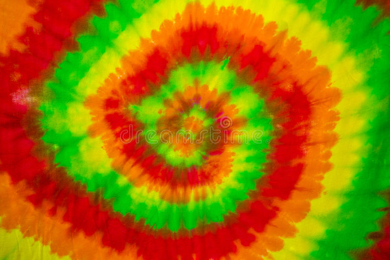 Colourful tie dyed pattern on cotton fabric stock image