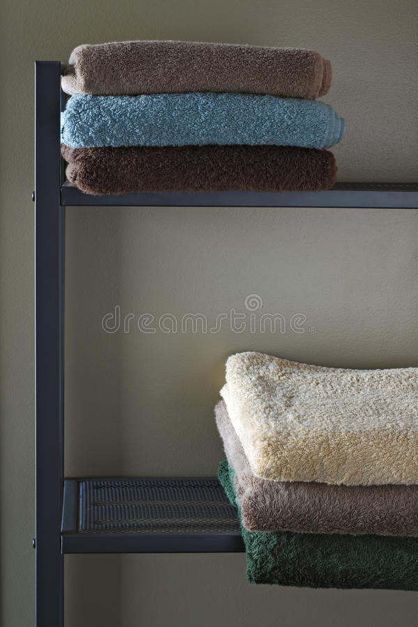 Colourful towels in a shelf. stock image