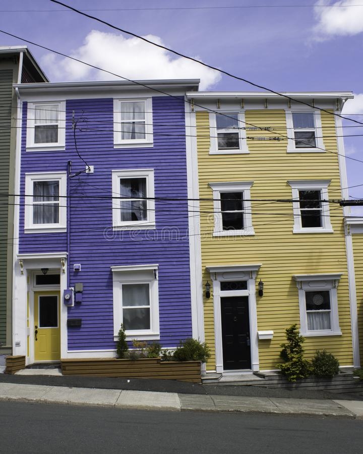 A blue and a yellow row home in Newfoundland, Canada. Colourful town homes in St. John`s Newfoundland Canada on a sunny day stock image
