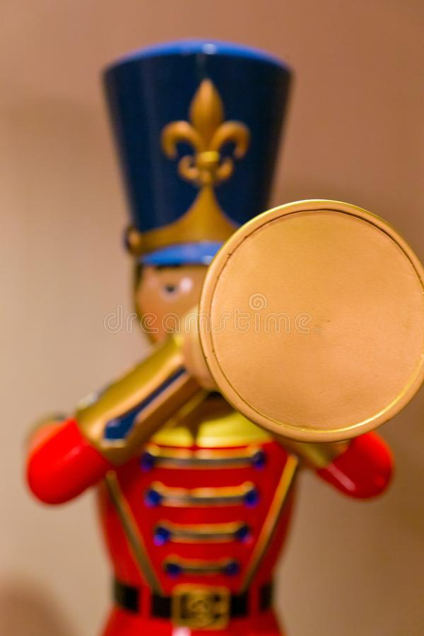 Colourful trumpet playing wooden doll stock photos