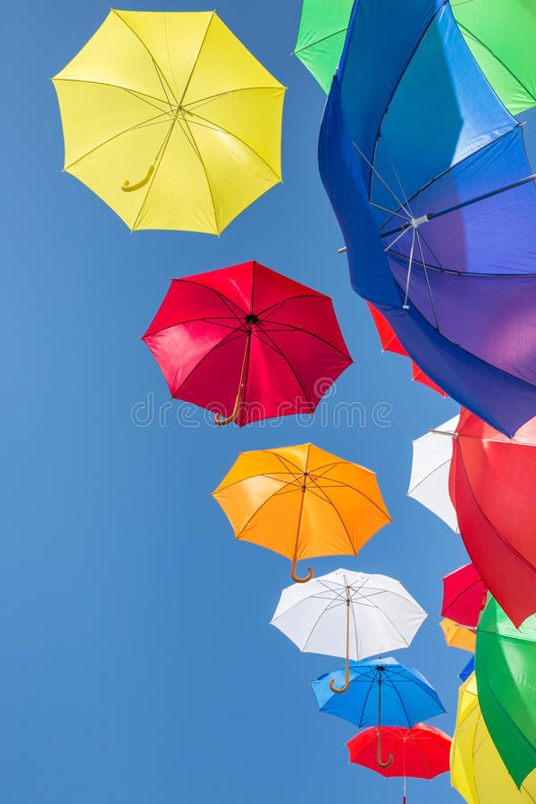 Free Colourful Umbrellas Against A Blue Sky Royalty Free Stock Photo - 42240875