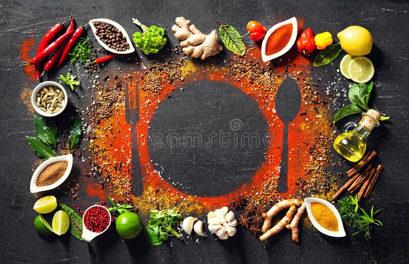 Colourful various herbs and spices for cooking on dark background royalty free stock photo