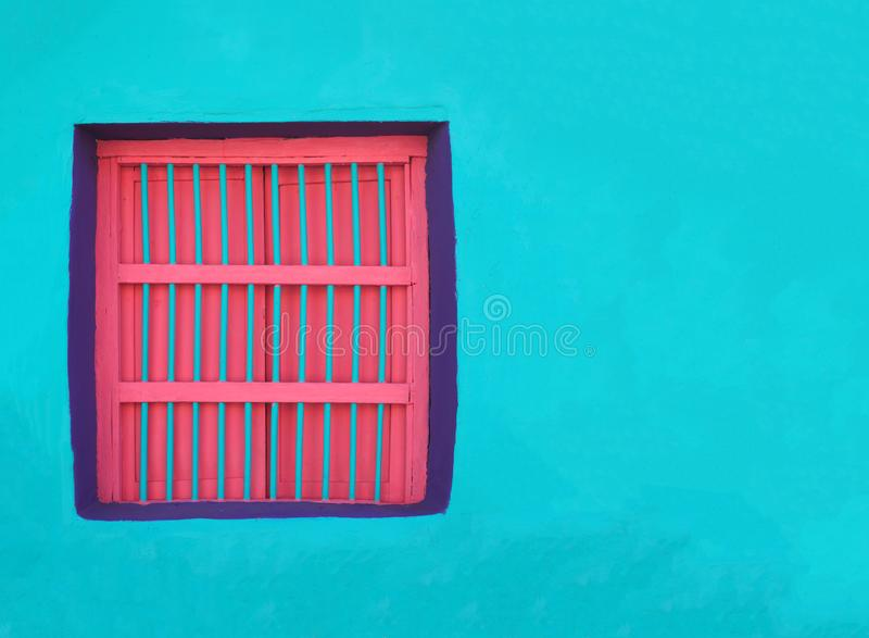 COLOURFUL WINDOWS & DOOR ARCHITECTURE - FLORES, GUATEMALA royalty free stock image