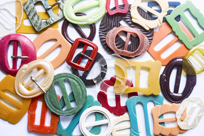 Colourful vintage belt buckles. Vintage and antique belt buckles made from celluloid, plastic and Bakelite stock photography