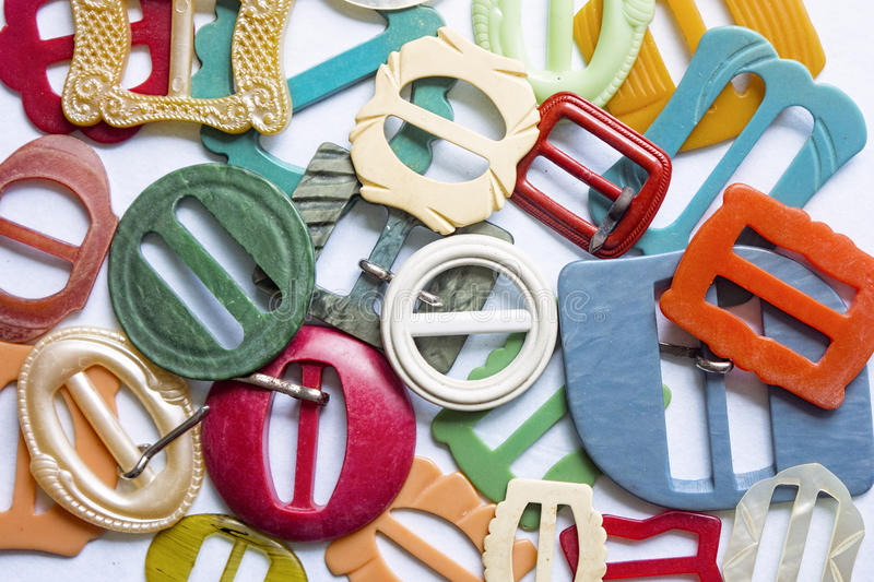 Colourful vintage belt buckles 2. Vintage and antique belt buckles made from celluloid, plastic and Bakelite royalty free stock images