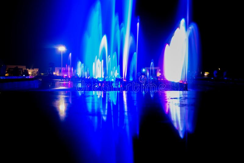 Colourful water fountain in night. Colourful water fountain night light show evening long longexposure royalty free stock images