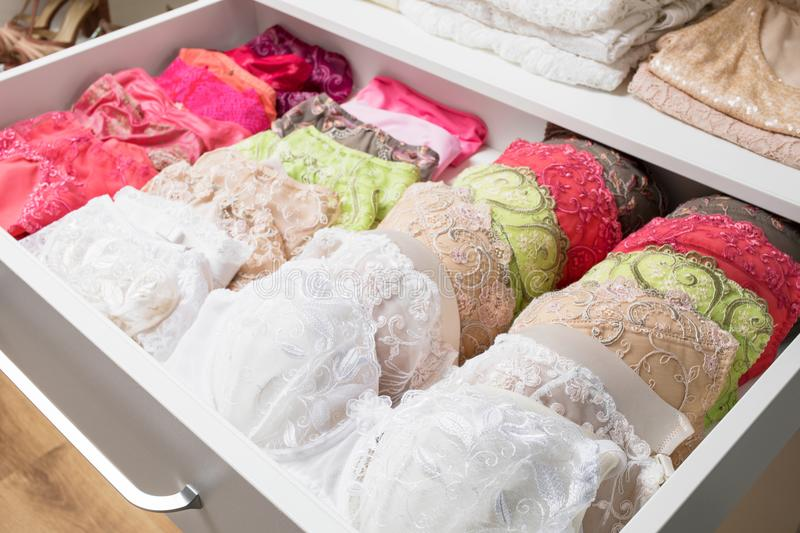 Colourful woman`s underwear in drawer. Excellent organized colourful woman`s underwear in drawer royalty free stock images