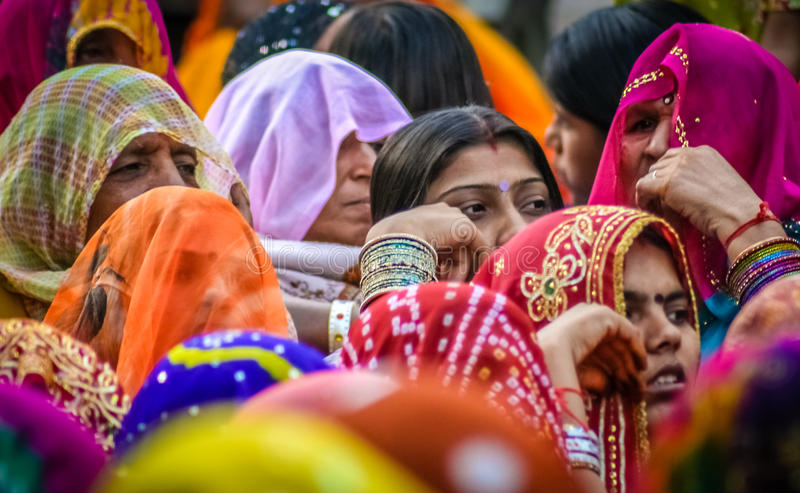 Colourful women of India. Colourful crowd of Indian women sitting together, Jaipur, India royalty free stock photo