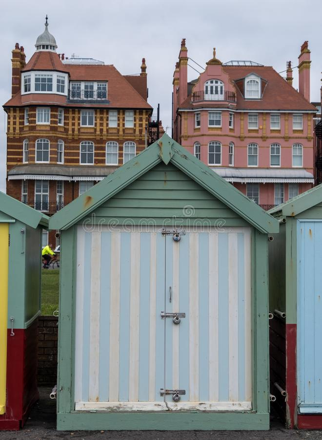 Colourful candy striped wooden beach hut on the sea front in Hove, Sussex, UK. Colourful wooden beach hut on the sea front in Hove, Sussex, UK with blocks of royalty free stock photos