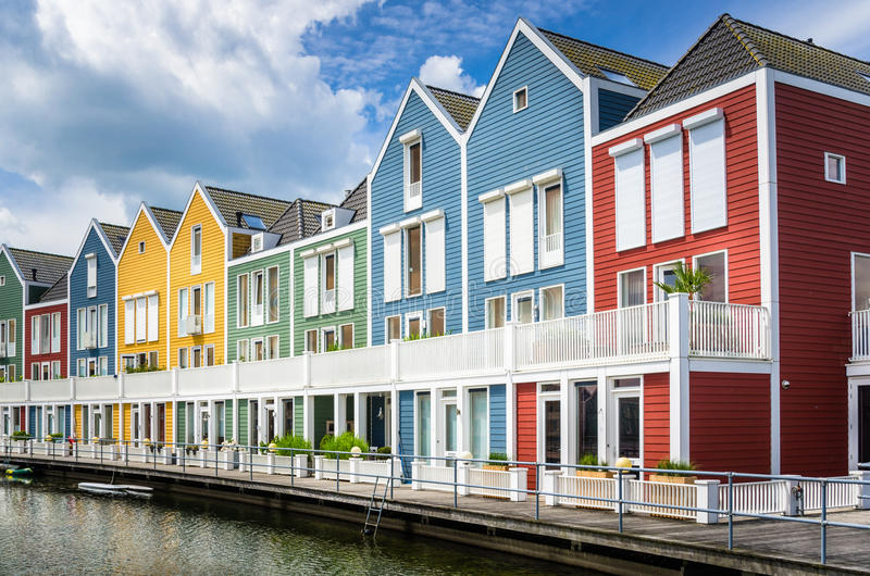 Colourful Wooden Houses. Colourful Wooden Row Houses and Blue Sky with Clouds stock image