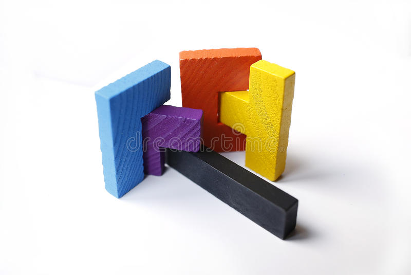 Colourful wooden puzzle blocks on white background. With shadow stock image